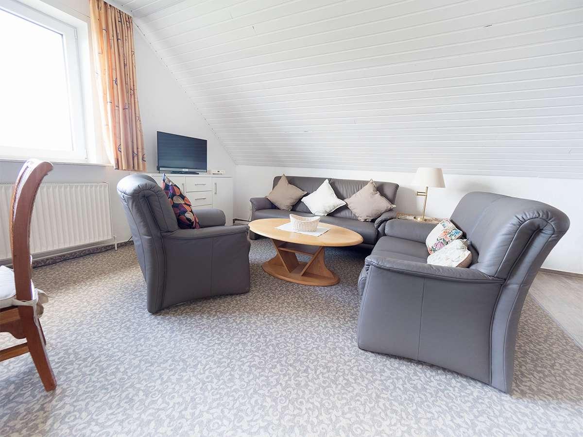 Die gemütliche Sitzecke in der Ferienwohnung 4 im Haus Meereswoge Norderney.